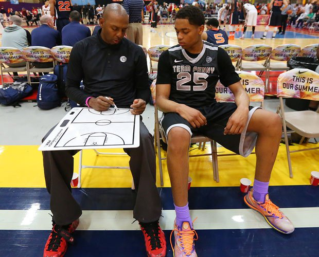 Four-time NBA All-Star Penny Hardaway instructs Paul Washington Jr. during Nike's EYBL opening session in Sacramento.