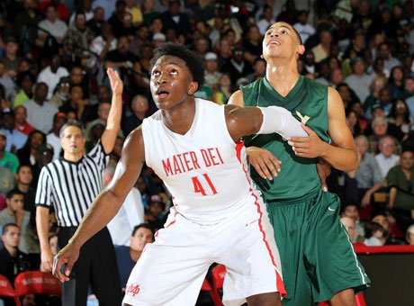 Stanley Johnson and Mater Dei are moving on in the CIF Southern California Regional Basketball Championships after beating Long Beach Poly.