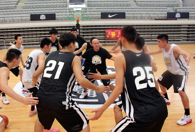 Coach Frank Allocco gives his signature defensive stance drill at the end of his first practice at the Nike High School Elite Camp in Shanghai, China.
