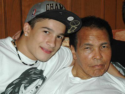 Biaggio Ali Walsh poses with his grandfather Muhammad Ali.