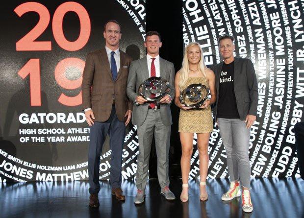 Gatorade national winners Bobby Witt Jr. and Kelley Lynch pose with presenters Peyton Manning and Abby Wambach.