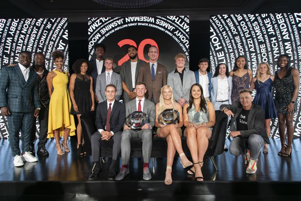 2019 Gatorade Female and Male Athlete of the Year award winners Kelley Lynch of East Coweta High School (Sharpsburg, Ga.) and Bobby Witt Jr. of Colleyville Heritage High School (Colleyville, Texas) pose with the pro athletes at the 2019 Gatorade Athlete of the Year Awards. Pictured from left to right: (top row) Sony Michel, Todd Gurley, Sage Steele, Allyson Felix, James Wiseman, Matthew Boling, Karl-Anthony Towns, Peyton Manning, Jake Smith, Omar Hernandez, Sophie Jones, Azzi Fudd, Katelyn Tuohy and Jasmine