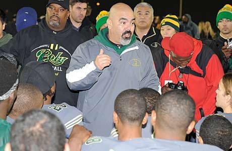 Long Beach Poly head coach Raul Lara addresses his team after last week's Regional victory over Clovis North.
