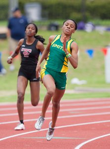 Texas-bound Courtney Okolo won her  third straight 400 on Friday in a  state-record time of 52.40.