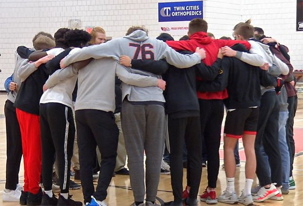 The 28-0 Eden Prairie squad huddles together one last time during a March 13 ceremony on campus after its season was cut short by COID-19 pandemic.