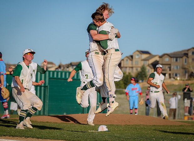 Drew Stahl and Zach Paschke of Mountain Vista (Colo.) celebrate Paschke's extra-inning walk-off hit on Senior Night against Heritage.