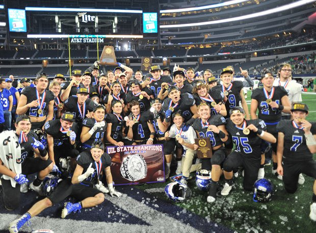 The Tigers celebrate their state title at AT&T Stadium in Dallas.