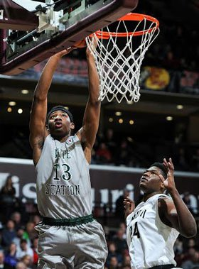 LaDarius Coleman goes up for two of his game-high 24 points Friday night against Paul VI.