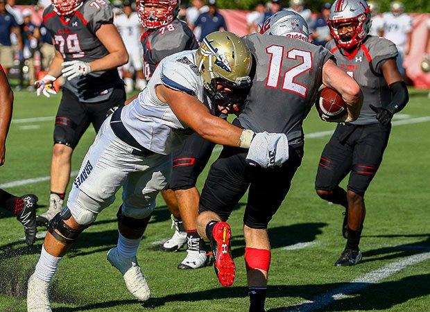 St. John Bosco's Sal Spina sacks St. John's quarterback Kevin Doyle.