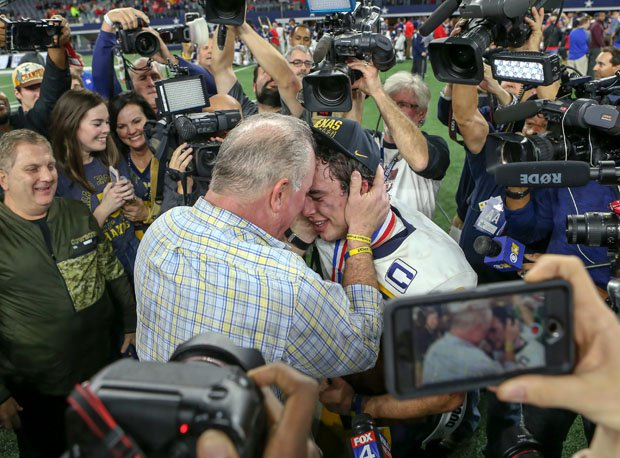 John Stephen Jones is embraced after the game by his dad and Executive Vice President, CEO, and Director of Player Personnel for the Dallas Cowboys, Stephen Jones.