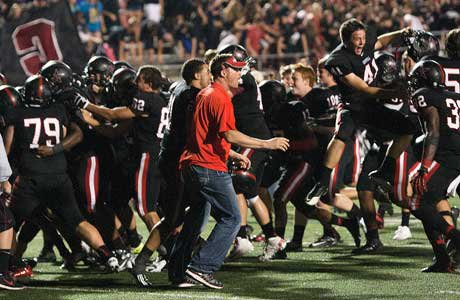 Coppell players and coaches celebrate their victory over Allen in overtime.