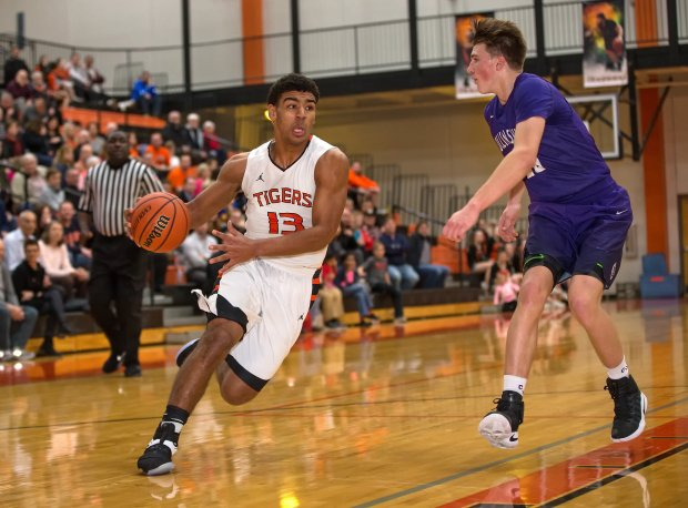 One of the hottest unsigned seniors in America, Edwardsville guard Mark Smith is averaging 21.8 points, 8.6 assists and 8.0 rebounds per game for the 24-1 Tigers.