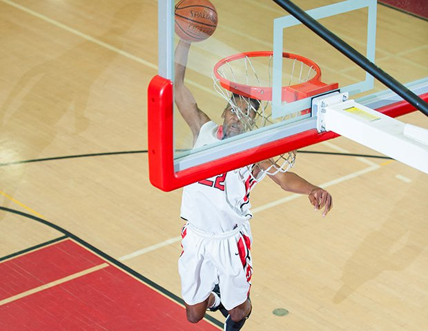 Jordan McGlory of James Logan (Calif.) soars in for a dunk against American High School.
