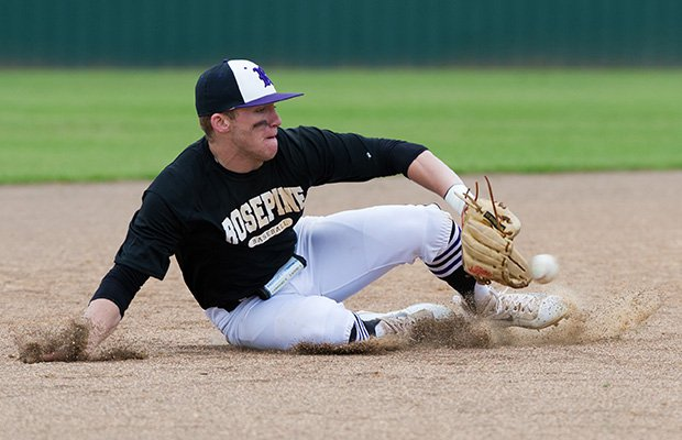 A Rosepine (La.) shortstop makes a sliding stop on a ground ball before getting up and throwing out the runner at first.