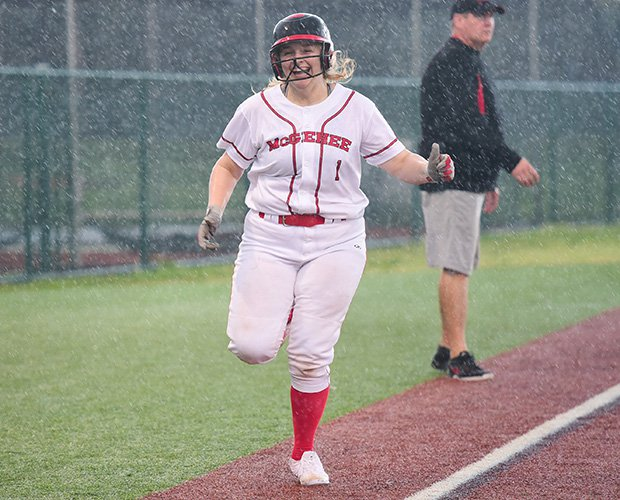 Katie Dunn of McGehee (La.) celebrates hitting a home run against Lusher during a rain storm.