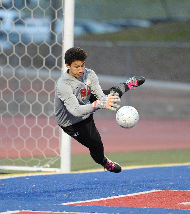 A Tesoro (Calif.) goalie deflects a shot during a game against El Toro.