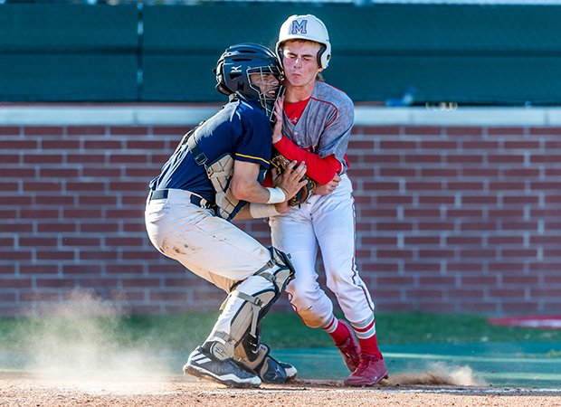 Jared Trozzo of Memorial (Texas) is tagged out at the plate by Cypress Ranch catcher Jared Alvarez-Lopez.