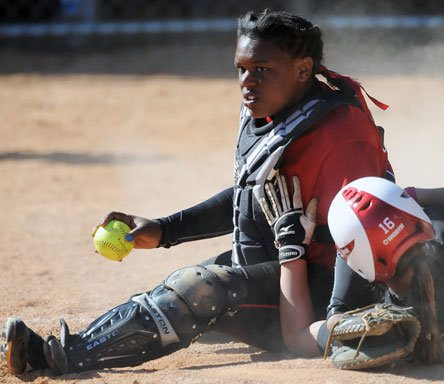 Denise Anderson of Dothan, the best softball team in Alabama, protects home plate like her team plans to protect its state title.