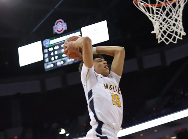 Moeller senior Jaxson Hayes (Texas) slams home two points during the Crusaders D-I semifinal win over Lorain.
