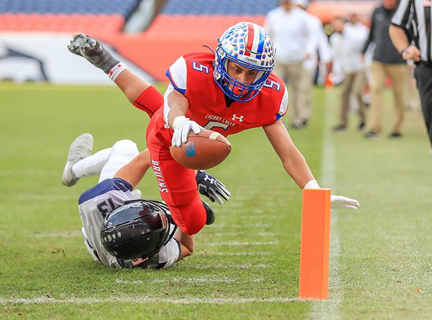Cherry Creek (Colo.) receiver James Walker II dives for a touchdown against Columbine in the CHSAA 5A state title game at Empower Field at Mile High.