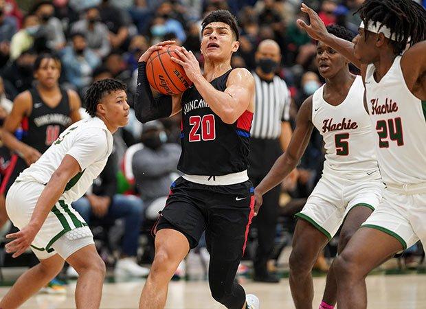 Duncanville guard Juan Reyna drives to the basket between three Waxahachie defenders.