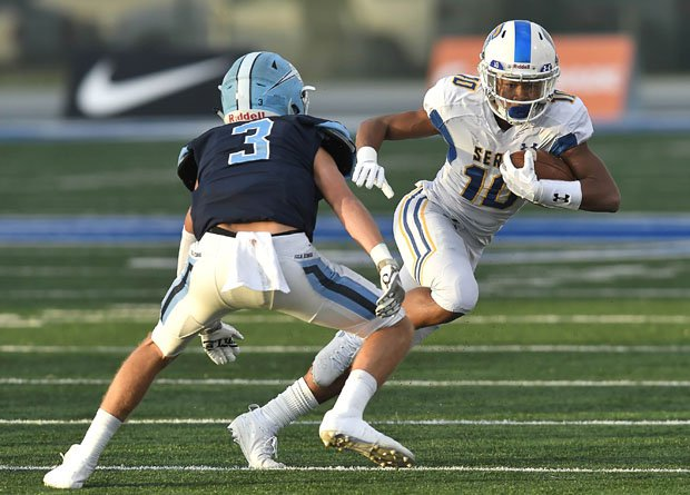 Action from the last day football was played in California, Dec. 14, 2019, when Corona del Mar defeated Serra 35-27 in the CIF D1-A title game.