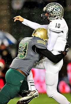 LaJay Kelly hits Granite Bay quarterbackGrant Caraway.