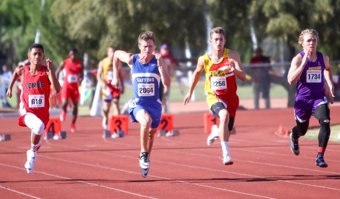 Luke Zuluaga (second from right, 2256) runs during the preliminaries at the AIA Track and Field Championships.
