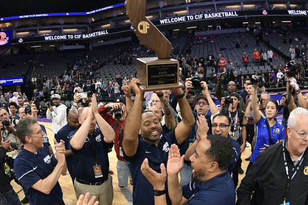 Sierra Canyon boys coach Andrew Chevalier holds up the Open Division trophy for a second straight year.