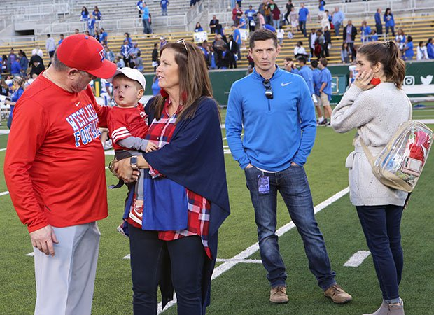 Todd and Riley along with their wives and Riley's youngest son, Landry, gather following Westlake's victory in last year's semifinals.