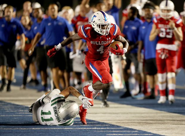 Four-star Folsom running back Daniyel Ngata was bottled up most of the night, but broke free here. He finished with 66 yards rushing and a late touchdown.