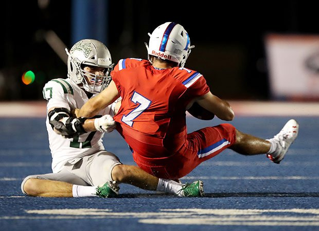 De La Salle defensive end Tanner Dougherty (17) with one of five sacks on Jake Reithmeier, who threw for 267 yards and three touchdowns.