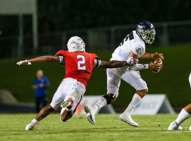 Narbonne quarterback Jake Garcia evades a big rush from Kendall Milton in his team's 32-6 win at Buchanan on Saturday night. Garcia threw for three touchdowns in the win.