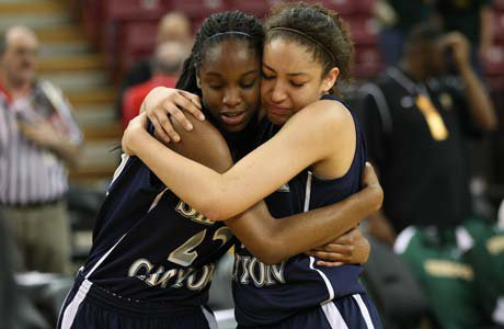 Sierra Canyon's Kennedy Burke (left) embraces Cheyanne Wallace following their team's first state championship win at Sleep Train Arena in Sacramento.