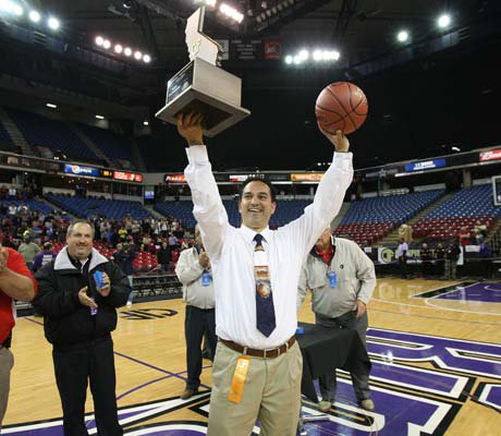 Pleasant Grove coach John DePonte displays the championship trophy following his team's historic win over Santa Monica to win the CIF State Division I title.