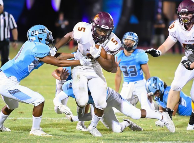 Bijan Robinson breaking tackles and looking for daylight last season against Cactus.