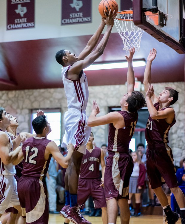 Charles Bassey is shown in action during a game Thursday in the St. Anthony Tournament.