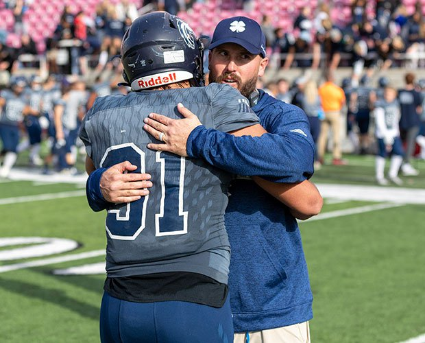 Corner Canyon head coach Eric Kjar celebrates with defensive lineman Van Fillinger.