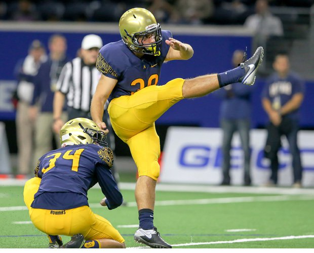 Aquinas kicker Marco Salani connects on one of his three first-half field goals.