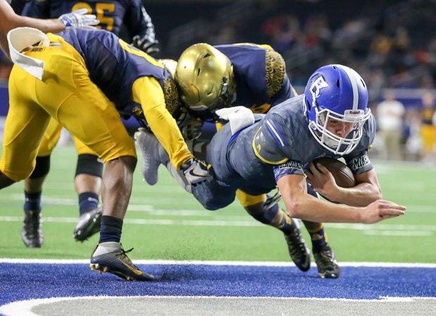 Bingham quarterback Matt Degn dives into the end zone while scoring on a 6-yard run.