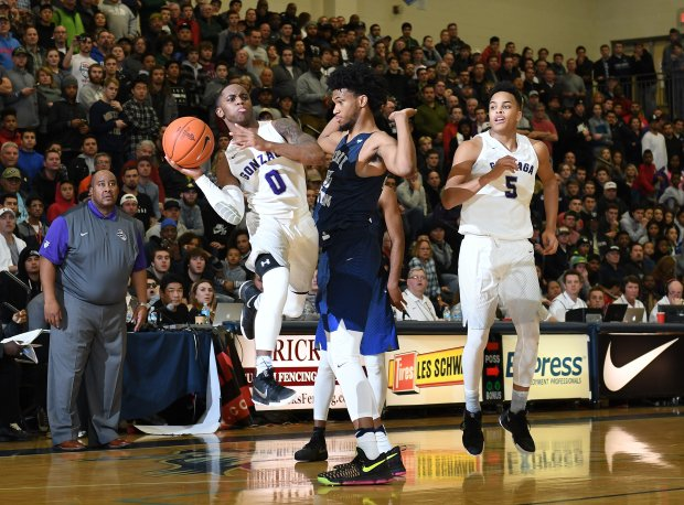 Miami signee Chris Lykes of No. 11 Gonzaga takes it to the basket against Marvin Bagley III in a December game at the Les Schwab Invitational in Oregon.