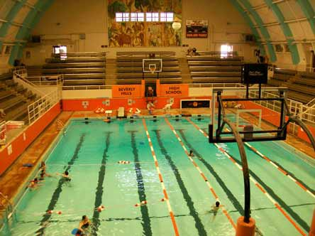 The Swim Gym at Beverly Hills High School hosts sports that don't seem to go together: Swimming/water polo and basketball/volleyball. Large motors push two halves of the wood floor over the pool. The gym is just one of a handful of America's unique high school sports venues.