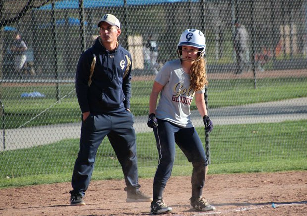 MaxPreps Director of Programing Steve Montoya coaching third base with his softball-playing daughter Whitney.