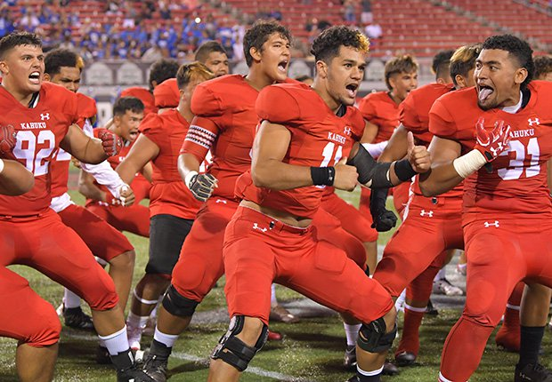 Kahuku players perform the Haka.