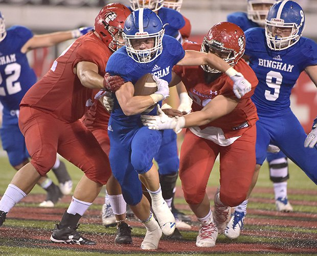 Bradon Wissler of Bingham grinds out yardage against Kahuku on Saturday night at the Polynesian Football Classic in Las Vegas.