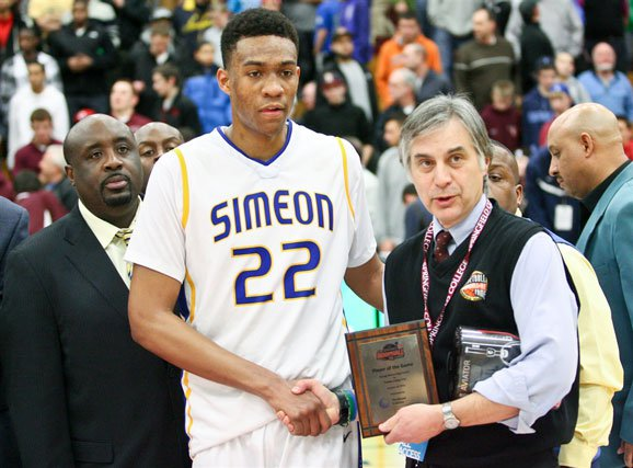 Jabari Parker with Simeon head coach Robert Smith (left) at the Spalding Hoophall Classic in January.