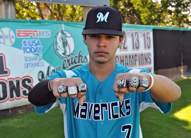 Jose Martinez of Archbishop McCarthy shows off the team's six state championship rings. The Mavericks will have to add a seventh after their win over Jesuit.