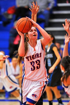 Los Lunas star Teige Zeller features awell-groomed skill set and a dedication to her faith as she tries to lead herteam to a state title.
