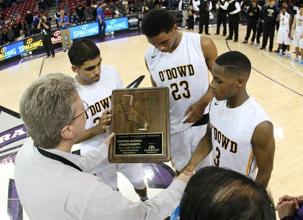 Bishop O'Dowd's captains accept the hardware presented by CIF Executive Director Roger Blake after winning their second straight Open Division Northern California title.