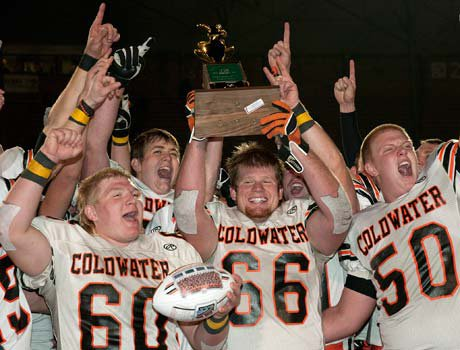 Coldwater players celebrate after winning the Ohio Division 5 title on Saturday.